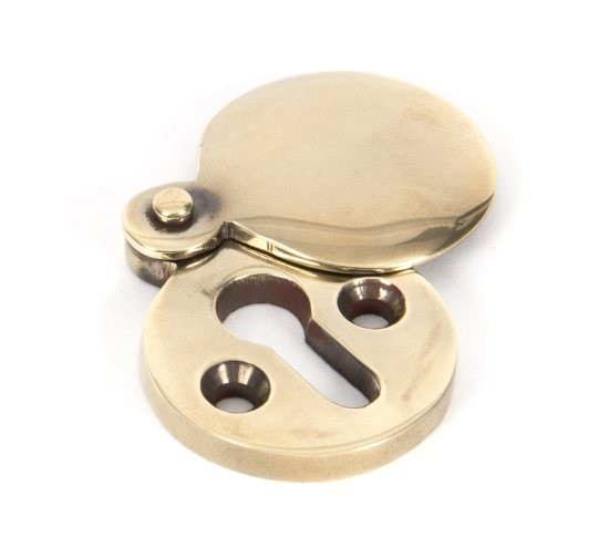 From The Anvil Aged Brass Round Escutcheon