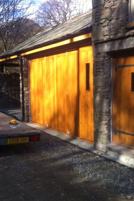 External bi-fold oak doors