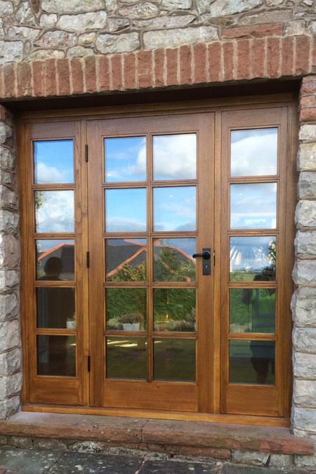 External glazed door with side panels